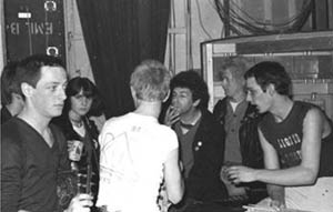 Charlie Harper of The UK Subs & members of Liquid Stone backstage